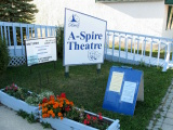 Photo Shoot - The playbill and sandwich board display outside the A-Spire Theatre. - SUPPRESSED DESIRES (Gimli Summer Theatre)